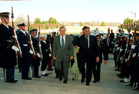Feb. 13, 2002, Washington, DC, United States<br /> <br /> Secretary of Defense Donald H. Rumsfeld (left) escorts Pakistani President Pervez Musharraf (right) through an honor cordon and into the Pentagon on Feb. 13, 2002.  The two leaders will meet to discuss the war on terrorism and defense issues of mutual interest.<br /> <br /> Mandatory Credit: Photo by DoD photo byHelene C. Stikke (Released)-