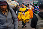 Flower sellers look like they are wearing dresses by Abdul Momin