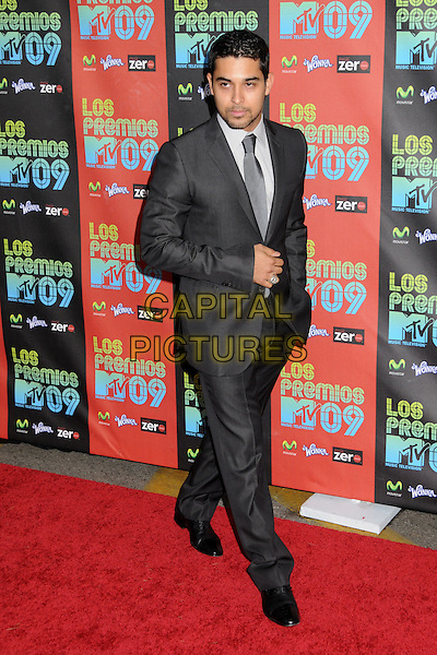 WILMER VALDERRAMA .MTV Los Premios Awards 2009 held at the Gibson Amphitheatre, Universal City, California, USA, 15th October 2009..full length grey gray silver suit tie black shoes ring .CAP/ADM/BP.©Byron Purvis/Admedia/Capital Pictures