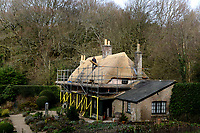 BNPS.co.uk (01202 558833)<br /> Pic: ZacharyCulpin/BNPS<br /> <br /> Master thatcher Scott Symonds puts the finishing touches to the new straw roof at the former home of Victorian author Thomas Hardy.<br /> <br /> The National Trust, which owns the picturesque cottage near Dorchester, Dorset, has closed the historic property for more than a month while it undergoes vital conservation work.<br /> <br /> On the inside new structural supports have been installed and the stone floor repointed after taking a battering from thousands of visitors over the years.<br /> <br /> And on the outside the roof has been re-thatched by Scott and his dad Dave who even appeared was an extra in the 2015 film adaptation of Hardy's Far From the Madding Crowd.