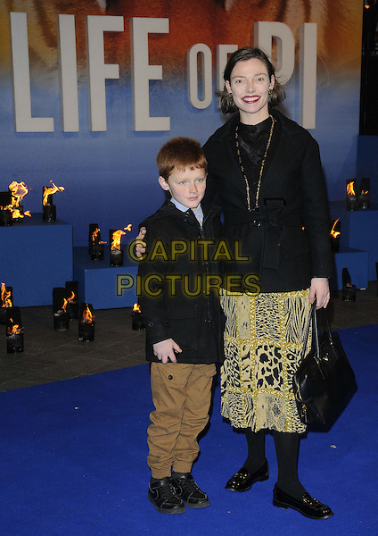 Hector Rutherford & Camilla Rutherford.'The Life Of Pi' UK film premiere, Empire cinema, Leicester Square, London, England.3rd December 2012.full length black jacket leopard zebra animal print skirt tights mother mom mum son kid child .CAP/CAN.©Can Nguyen/Capital Pictures.