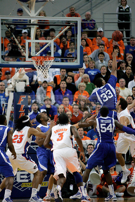 Kentucky freshman Daniel Orton attempts to block as Florida basket during the first half of the Cats' game against the Gators at the Stephen C. O'Connell Center in Gainesville, Fla. on Tuesday, Jan. 12, 2009.