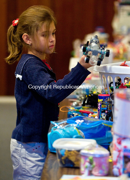 MIDDLEBURY, CT - 06 DECEMBER 2008 -120608JT04-<br /> FOR COUNTRY LIFE: Isabela Kay, 7, gets some holiday shopping done at the Middlebury Public Library's annual Holiday Sale for children on Friday. The event also provided helpers and gift wrapping for shoppers. Simultaneously at the library was a bake sale and a silent auction.<br /> Josalee Thrift / Republican-American