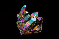 TITANIUM COATED QUARTZ CRYSTAL<br /> Spectral Colors Caused By Thin-film Interference<br /> These coated quartz are the result of magnetron ionization.  The process results in a permanent coating bonded to the crystal at a molecular level. Applications of thin film technology include electronics, optics etc.