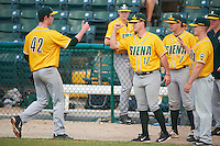 Siena Saints starting pitcher Tommy Miller (42) fist bumps Ryan Bellomo (17), Max Goione (7), and Dan Lowndes (8) after being pulled during a game against the Pittsburgh Panthers on February 24, 2017 at Historic Dodgertown in Vero Beach, Florida.  Pittsburgh defeated Siena 8-2.  (Mike Janes/Four Seam Images)
