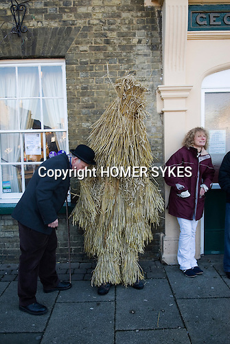Straw Bear Festival. Whittlesea Whittlesey Cambridgeshire UK 2008. Straw Bear and handler outside the George Hotel.