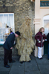 Straw Bear Festival. Whittlesea Whittlesey Cambridgeshire UK 2008. Straw Bear and handler outside the George Hotel.
