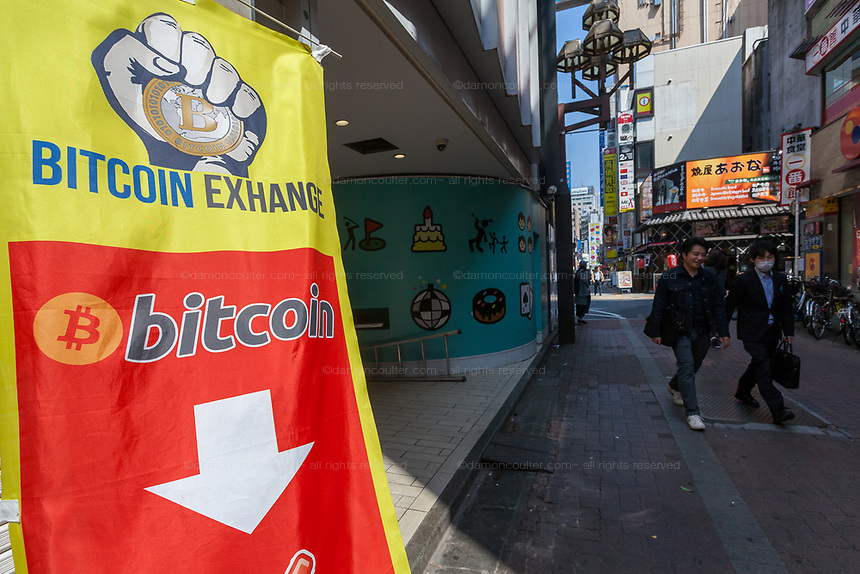 A sign for a Bitcoin exchange in Kabukicho, Shinjuku, Tokyo, Japan Friday April 20th 2018. Japan elevated crypto-currencies  to the same status as other forms of money in March 2016 then in April 2017 allowed businesses to use Bitcoin as a legitimate form of payment. This led to large value hikes on this digital currency. Investing and using Bitcoins continues to gain popularity in Japan despite recent drops in their trading value.