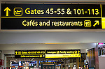 Signs for gates cafes and restaurants, departure lounge, Gatwick airport north terminal, London, England, UK