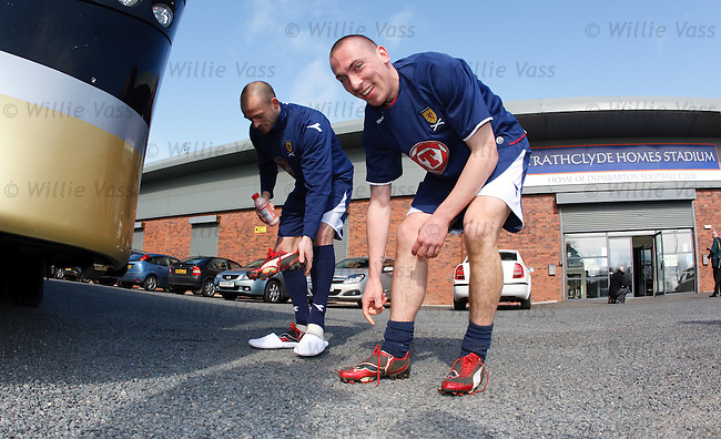 Scott Brown and Steven Fletcher changing their boots before gettng on the team bus after training