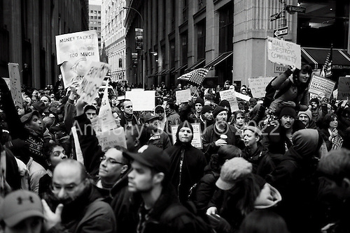 New York, New York<br /> November 17, 2011<br /> <br /> &quot;Occupy Wall Street&quot; protesters mark the movement's two-month milestone by marching from Zuccotti Park, in mass, to various access streets surrounding the New York Stock Exchange, which the police had barricaded off. Yet instead of the police keeping protesters out, protesters locked down those entrances to Wall Street and the New York Stock Exchange creating havoc as the police made more then 240 arrests to try and keep the streets open to normal traffic.<br /> <br /> Thousands of protesters are meet with barricades, police on houses and baton wielding riot police at Nassau just one block form the NYSE.