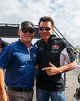 Apr 22, 2017; Baytown, TX, USA; Papa John's pizza founder John Schnatter (right) with track owner Seth Angel during NHRA qualifying for the Springnationals at Royal Purple Raceway. Mandatory Credit: Mark J. Rebilas-USA TODAY Sports