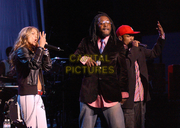 FERGIE OF THE BLACK EYED PEAS.performs live at The Wiltern Theatre in Los Angeles, California .25 March 2004.*UK Sales Only*.live, music, gig, stage, concert, singing.www.capitalpictures.com.sales@capitalpictures.com.©Capital Pictures.
