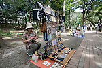 A woman sells handmade pouches and mobile phone cases made from traditional kimono materials at the Art Market inside Inokashira Park in the trendy neighborhood of Kichijoji in Musashino City,  Tokyo, Japan on 16 Sept. 2012.  Photographer: Robert Gilhooly