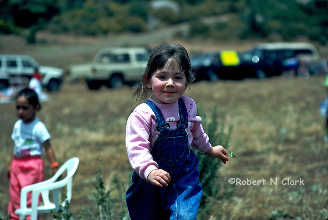 Young girl running in field smiling