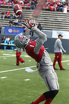 Vince Mayle hauls in a pass during preparation for the annual Washington State Cougar spring game, the Crimson and Gray game, at Joe Albi Stadium in Spokane, Washington, on April 26, 2014.
