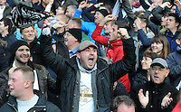 Swansea fans celebrate victory during the Barclays Premier League match between Aston Villa v Swansea City played at the Villa Park Stadium, Birmingham on October 24th 2015