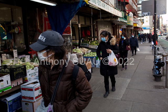 New York, New York<br /> March 18, 2020<br /> 12:54 PM<br /> <br /> Manhattan under coronavirus pandemic. <br /> <br /> Shoppers wearing face mask and gloves fearing the spread of the virus in downtown Manhattan.