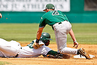 April 23, 2011:   Jacksonville University Dolphins of/1b Adam Brett Walker (28) escapes the tag of Stetson Hatters 2b Robert Crews (2) during Atlantic Sun Conference action between Stetson Hatters and Jacksonville University Dolphins at John Sessions Stadium in Jacksonville, Florida.  Jacksonville defeated Stetson 10-4...........