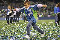 Fans of the Seattle Sounders FC run on the field after their victory. The Seattle Sounders FC defeated the Columbus Crew 2-1 during the US Open Cup Final at Qwest Field in Seattle,WA, on October 5, 2010.