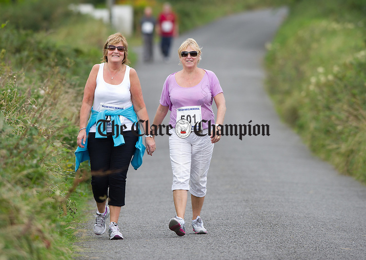 Walkers Margaret O Rahilly and Frances Byrnes taking part in the Declan Hayes Memorial Doonbeg Half Marathon/10K Fun Run and Walk. Photograph by John Kelly.