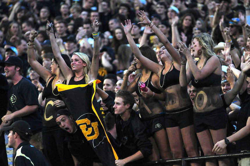 18 September 08: Colorado fans cheer after a touchdown against West Virginia.  The Colorado Buffaloes defeated the West Virginia Mountaineers 17-14 in overtime at Folsom Field in Boulder, Colorado. For Editorial Use Only.