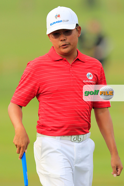 Nicholas Fung (MAY) Team Asia on the 1st green during Match 1 of Friday's Fourball Matches of the 2016 Eurasia Cup presented by DRB-HICOM, held at the Glenmarie Golf &amp; Country Club, Kuala Lumpur, Malaysia. 15th January 2016.<br /> Picture: Eoin Clarke | Golffile<br /> <br /> <br /> <br /> All photos usage must carry mandatory copyright credit (&copy; Golffile | Eoin Clarke)