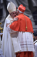 Pope Francis (R) puts the biretta as he appoints Cardinal Guatemalan prelate Alvaro Leonel Ramazzini Imeri (L) during an Ordinary Public Consistory for the creation of new cardinals, for the imposition of the biretta, the consignment of the ring and the assignment of the Title or Diaconate, on October 5, 2019 at St. Peter's Basilica in the Vatican. Pope Francis appoints 13 new cardinals at the 2019 Ordinary Public Consistory, choosing prelates whose lifelong careers reflect their commitment to serve the marginalized and local church communities, hailing from 11 different nations and representing multiple religious orders.