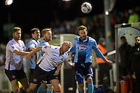 Andy Monkhouse of Grimsby Town wins the header from Lee Minshull of Bromley during the Vanarama National League match between Bromley and Grimsby Town at Hayes Lane, Bromley, England on 9 February 2016. Photo by Alan  Stanford.