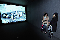 HONG KONG - MARCH 12:  Visitors stand next to animation 'Felix in exile' by William Kentridge, as part of the exhibition 'Moving Images' organized by M+ organization on March 12, 2015 in Hong Kong, Hong Kong.  (Photo by Lucas Schifres/Getty Images)
