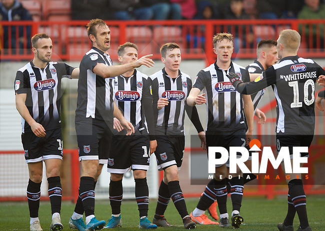 James Hanson of Grimsby Town celebrates after scoring to make it 1-2 during the Sky Bet League 2 match between Crawley Town and Grimsby Town at The People's Pension Stadium, Crawley, England on 25 January 2020. Photo by Alan  Stanford / PRiME Media Images.