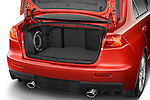 Open trunk compartment showing subwoofer speaker on a 2008 Mitsubishi Lancer Evolution