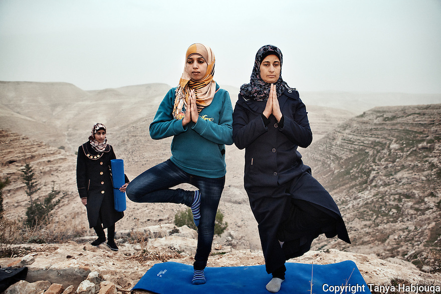 West Bank: Hyatt (left) recently took a yoga lesson from a visiting American yoga instructor. She is now teaching the young residents of her village, Zataara, a small village on the outskirts of Bethlehem in the West Bank. The women are increasing in number each week--and they say it is proving to be the ultimate release.  2012