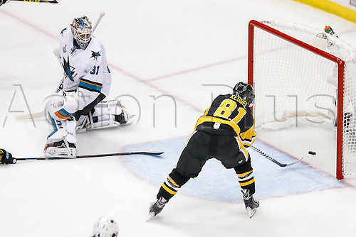 June 1, 2016:  Pittsburgh Penguins right wing Phil Kessel (81) scores goal as San Jose Sharks goalie Martin Jones (31) looks on during the San Jose Sharks and Pittsburgh Penguins NHL Stanley Cup playoff game at Consol Energy Center in Pittsburgh, PA. Pittsburgh beat San Jose in overtime, 2-1.