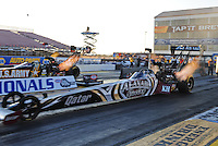 Feb. 17 2012; Chandler, AZ, USA; NHRA top fuel dragster driver Shawn Langdon (near lane) races alongside Tony Schumacher during qualifying for the Arizona Nationals at Firebird International Raceway. Mandatory Credit: Mark J. Rebilas-