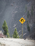 sharp turn road sign up rock creek drainage in montana