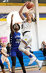 SEYMOUR CT. - 17 January 2020-011720SV09-#21 Morgan Teodosio of Seymour High goes up a shot over #30 Takaia Lewis of Crosby High during basketball action in Seymour Friday.<br /> Steven Valenti Republican-American