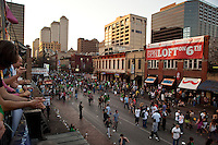A long tradition, crowds pack the downtown streets for St. Patrick's Day celebration on 6th Street in Austin, Texas
