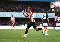 8th February 2020; Griffin Park, London, England; English Championship Football, Brentford FC versus Middlesbrough; Ollie Watkins of Brentford celebrates after scoring his sides 3rd goal in the 87th minute to make it 3-2 - Strictly Editorial Use Only. No use with unauthorized audio, video, data, fixture lists, club/league logos or 'live' services. Online in-match use limited to 120 images, no video emulation. No use in betting, games or single club/league/player publications