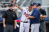 Danville Braves manager Nestor Perez (4) goes over the ground rules with Princeton Rays manager Danny Sheaffer (29), first base umpire Lance Seilhamer (left), and home plate umpire Brandon Blome prior to the Appalachian League game at American Legion Post 325 Field on June 25, 2017 in Danville, Virginia.  The Braves walked-off the Rays 7-6 in 11 innings.  (Brian Westerholt/Four Seam Images)