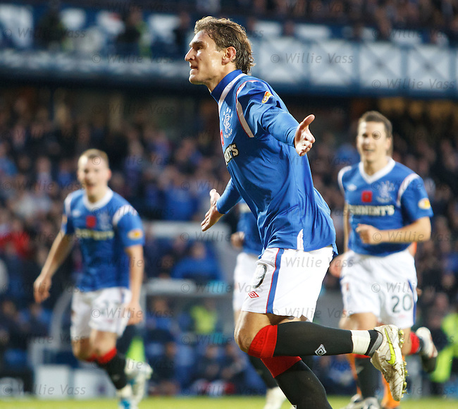 Nikica Jelavic celebrates after scoring from the spot