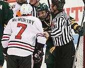 Mike McMurtry (NU - 7), Mario Puskarich (UVM - 21), Kevin Keenan - The visiting University of Vermont Catamounts defeated the Northeastern University Huskies 6-2 on Saturday, October 11, 2014, at Matthews Arena in Boston, Massachusetts.