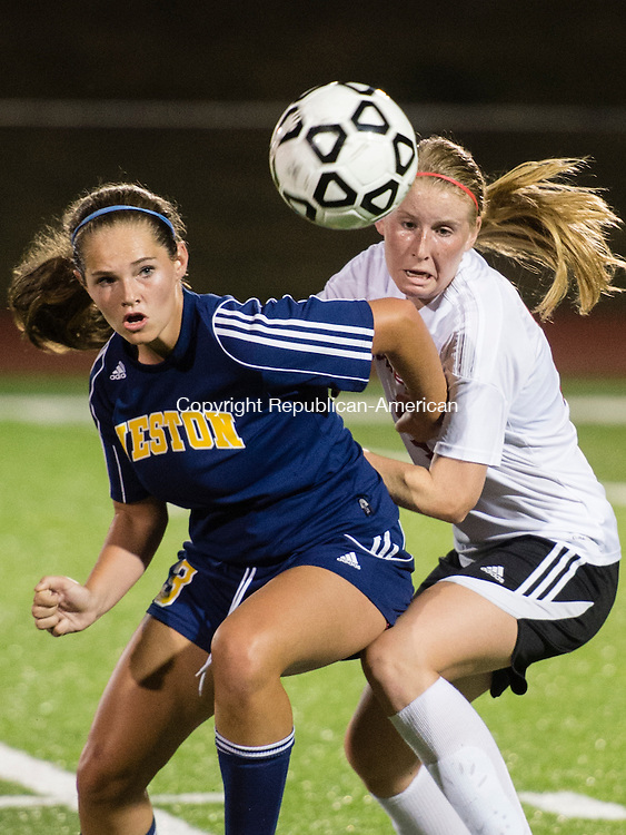 SOUTHBURY, CT - 24 September 2015-092415EC07-- Weston's Alexandra Alwang and Pomperaug's Lindsey McCormack battle for possession of the ball Thursday night in Southbury. Erin Covey Republican-American.