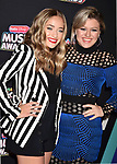 HOLLYWOOD, CA - JUNE 22: Brynn Cartelli (L) and Kelly Clarkson arrive at the 2018 Radio Disney Music Awards at Loews Hollywood Hotel on June 22, 2018 in Hollywood, California.