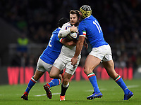 Elliot Daly of England is double-tackled by Luca Morisi and Angelo Esposito of Italy. Guinness Six Nations match between England and Italy on March 9, 2019 at Twickenham Stadium in London, England. Photo by: Patrick Khachfe / Onside Images