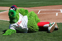 March 4, 2010:  Philadelphia Phillies mascot the Philly Phanatic entertains fans by posing and strutting for a group of photographers during a Spring Training game at Bright House Field in Clearwater, FL.  Photo By Mike Janes/Four Seam Images