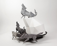 Origami timber wolf pack designed and folded by Paul Frasco