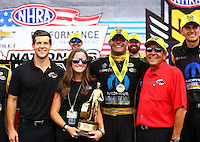 Sep 5, 2016; Clermont, IN, USA; NHRA funny car driver Matt Hagan (center) celebrates with team owner Don Schumacher (right) and daughter Megan Schumacher after winning the US Nationals at Lucas Oil Raceway. Mandatory Credit: Mark J. Rebilas-USA TODAY Sports