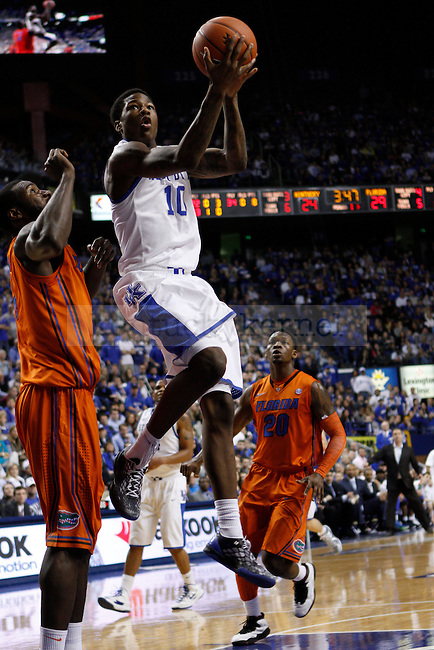 UK's Archie Goodwin takes the ball to the net. The Cats and Gators went into halftime tied at 31 points apiece. in Lexington, Ky., on Sunday, March, 10, 2013. Photo by James Holt | Staff
