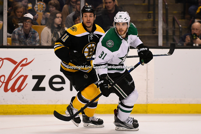February 10, 2015 - Boston, Massachusetts, U.S. - Boston Bruins center Gregory Campbell (11) and Dallas Stars center Tyler Seguin (91) in game action during the NHL match between the Dallas Stars and the Boston Bruins held at TD Garden in Boston Massachusetts. Dallas defeated Boston 5-3 in regulation time. Eric Canha/CSM